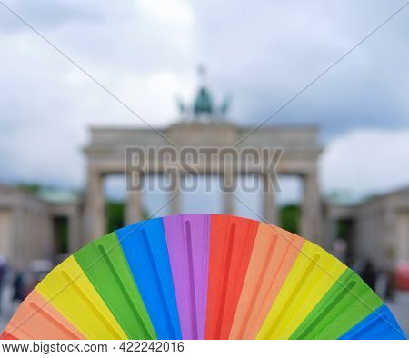 Rainbow Fan In Hand, Symbol Of Lgbtqia Gay Lesbian Pride And Diversity Including Covid Dissidents. G