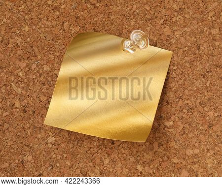 Shiny blank gold sticky note pinned with tack. Golden idea or message concept.