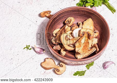 Dried Mushrooms Boletus Edulis (penny Bun, Cep, Porcini) On Textured Plaster Background
