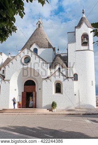 Alberobello, Italy - June 30, 2014: Tourist Visiting A Church In Trulli Village In Alberobello, Ital