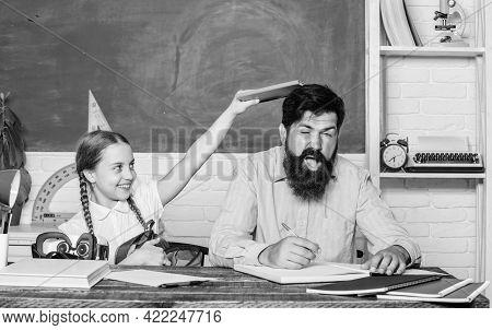 Study Is Fun. School Teacher And Schoolgirl. Homeschooling With Father. Man Bearded Pedagogue Study