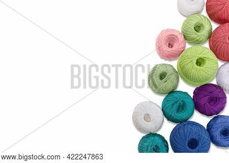 Multicolored Balls And Bobbins Of Woolen Yarn, Wooden Thread Sleeves On White Isolated Background. N