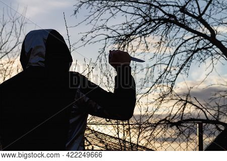 A Knife In The Hand Of A Man With A Sharp Steel Blade In The Park As A Weapon Or A Means Of Self-def