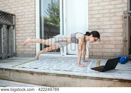 Middle Age Caucasian Woman Doing Push-ups Exercises On Home Backyard Online. Video Fitness Sport Wor