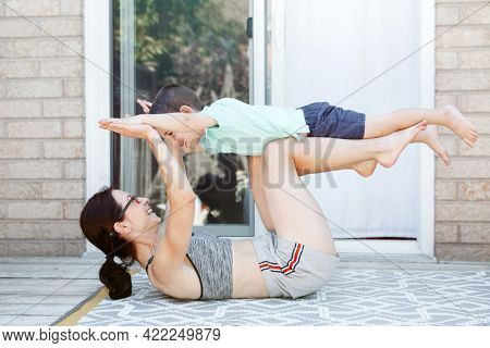 Family Sport Activity. Caucasian Mother With Toddler Son Doing Distant Remote Online Fitness Workout