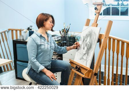 Creative Hobby Occupation. Caucasian Woman Artist Drawingportrait With Pencil On Canvas At Home Art