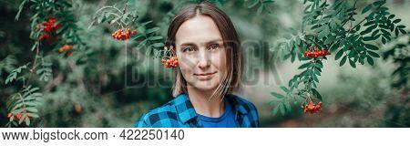Autumn Fall Summer Woman Portrait In Rowan Tree Berries. Closeup Of Pensive Caucasian Middle Age Wom