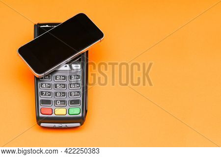 Payment Terminal And Smartphone With Copy Space. Contactless Payment For Goods. E-commerce And Busin