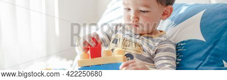 Baby Toddler Boy Playing With Learning Toy Stacking Building Blocks At Home. Early Age Montessori Ed