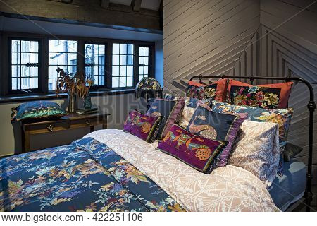 London, Uk - December 22, 2020: Interior In The Bedrooms Department. Ornamental Bed With Patchwork D
