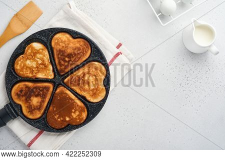 Kes In Shape Of Breakfast Hearts In The Frying Pan With Ingredients For Cooking. Healthy Breakfast O