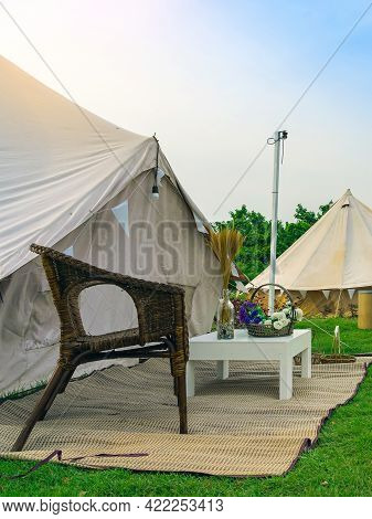 Holiday Tents And Lounge Areas On Green Lawn Place Among Trees At Natural Parkland. Camping Tent On