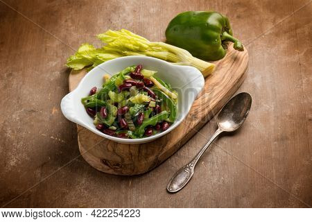 Fresh salad with red beans pepper and celery
