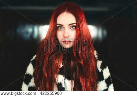 Portrait Of A Beautiful Woman With Red Hair Standing In The Underground Passage