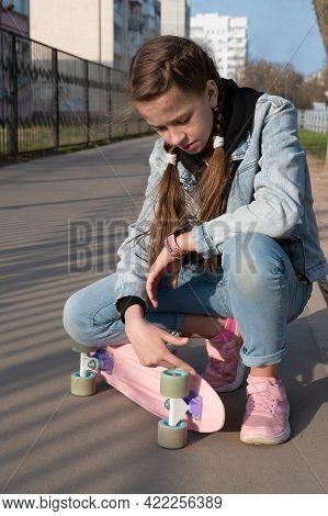 Cute Girl In Denim And Pink Sneakers And Penny Board, Longboard . International Skateboarding Day. S
