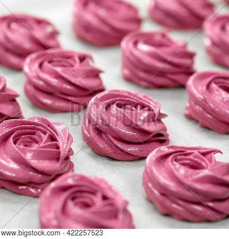 Marshmallow Cooking Process. Pink Rose Shaped Desserts Out Of Pastry Bag On Parchment Paper, Close U