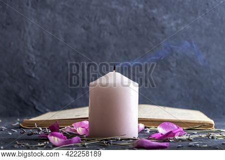 Magic Still Life With Pink Candle And Old Herbalist Book. Esoteric And Pagan Rituals, Witchcraft Wic