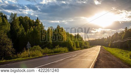 Country Road With Markings In The Middle Of The Forest. Path And Forward Movement In The Sun. Beauti