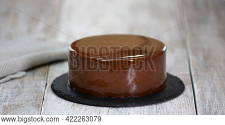 The Mousse Cake Is Decorated With Chocolate Mirror Glaze. Modern Dessert.