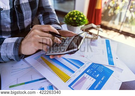 Realtor Agent Or Businessman Calculating To Count Loan, Money Or Home Insurance, Cost Mortgage, Loan