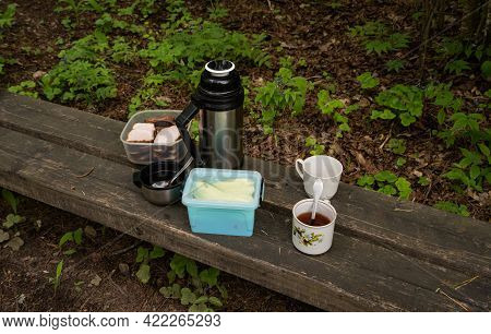Picnic, Teacup, Meatbread, Thermos On A Wooden Bench, Green