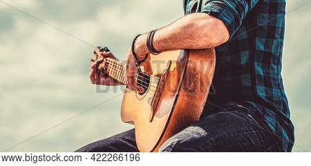 Mans Hands Playing Acoustic Guitar, Close Up. Acoustic Guitars Playing. Music Concept