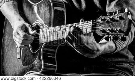 Music Concept. Male Guitarist Plays. Black And White