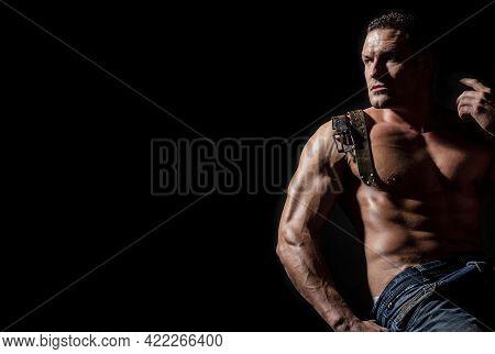 Strong Brutal Guy. Sexy Torso. Leather Belt, Jeans. Handsome Big Muscles Man Posing At Studio. Model