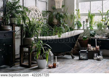 Freestanding Bathtub In Corner Of Wide Light Boho Chic Bathroom With Big Window, Wooden Antique Furn