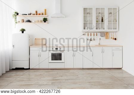 New Apartment, Modern Renovation. White Kitchen Furniture With Utensils, Shelves With Crockery And P