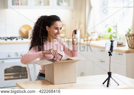 Unboxing Video. Excited Happy Brunette Lady Unpacking Parcel With Cosmetics At Camera