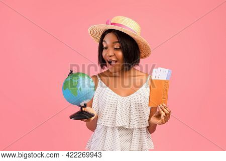 Happy Black Woman Holding Globe, Passport And Plane Tickets, Traveling Around World, Having Abroad T