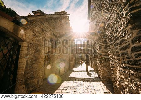 Tallinn, Estonia. People Tourists Walking In St. Catherines Passage From St. Catherines Dominican Mo