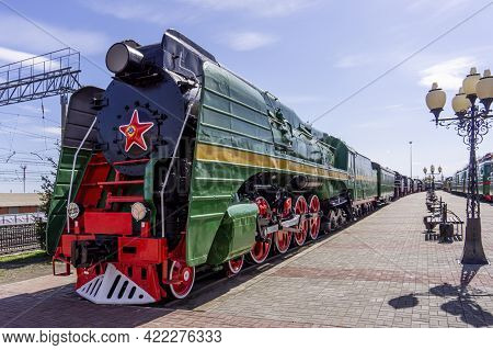Chelyabinsk, Chelyabinsk Oblast, Russia-may 05.2021 Green Retro Steam Locomotive. Vintage Locomotive