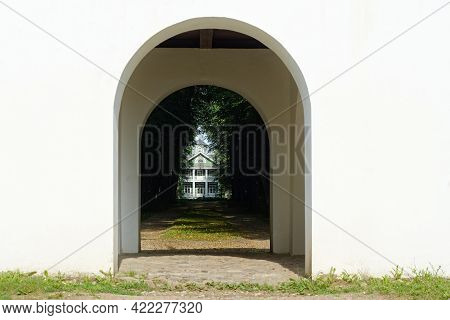 View Of The Wooden House Through The Arch Of The Observation Gazebo In The Petrovskoye Estate In The
