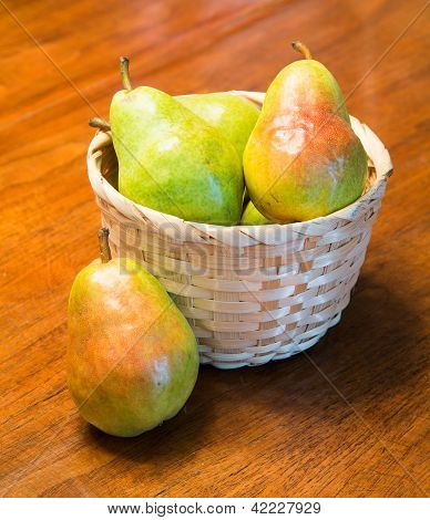 Pear By Basket Full Of Pears