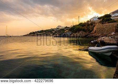Sunset In Finikas Port On Siros Island, Greece, With Sailing Boats, Dinghy And Traditional Whitewash