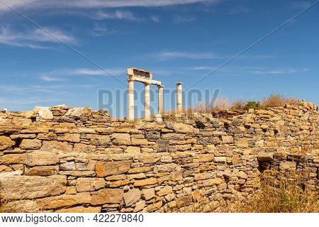 Antique Doric Columns And Stone Wall On Delos Island - Mythological, Historical, And Archaeological