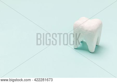 Health Dental Care Concept. White Healthy Tooth Model Isolated On Pastel Blue Background. Teeth Whit
