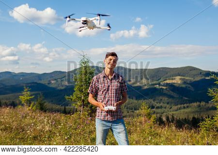 Aerial Drone Footage Shooting Of Summer Carpathins. Man Operating Copter Controller In Mountains. To