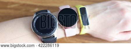 Three Different Wristwatches Are Wornning On Womans Hand Closeup