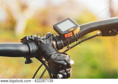 Bicycle Computer Mounted On A Bicycle Handlebar.