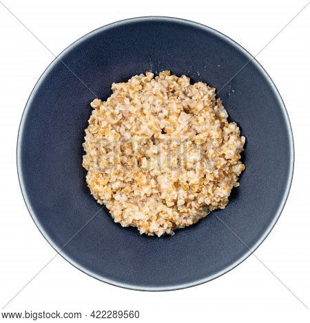 Top View Of Porridge From Boiled Crushed Emmer Farro Hulled Wheat Groats In Round Bowl Isolated On W