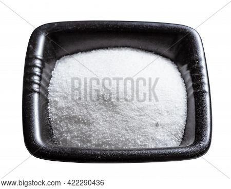 Crystalline Monosodium Glutamate Flavoring In Black Bowl Isolated On White Background