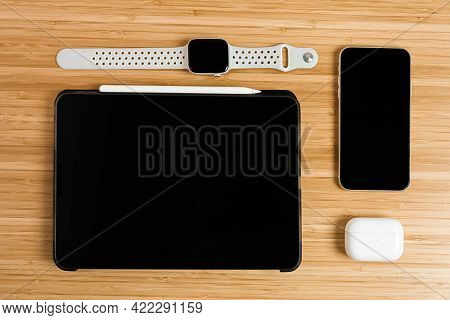 Apple Watch, Ipad, Iphone, Airpods Pro On The Wooden Table, May 2021, San Francisco, Usa