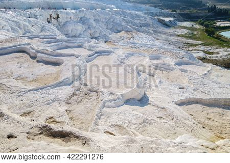 Travertine Pools Or Terraces Pamukkale, Turkey. White Rocks Included In National Reserve & In Unesco
