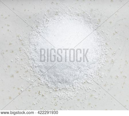 Top View Of Pile Of Sugar Substitute - Crystalline Extract Of Stevia Plant Close Up On Gray Ceramic
