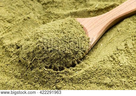 Above View Of Wooden Spoon With Milled Stevia Rebaudiana Herb (natural Sugar Substitute) Close Up On