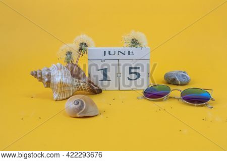 Calendar For June 15: Cubes With The Number 15, The Name Of The Month Of June In English, Shells, Se
