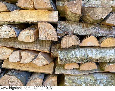 A Lot Of Wooden Logs And Logs Cooked For The Winter In A Wood-burning Stove To Light The Fireplace A